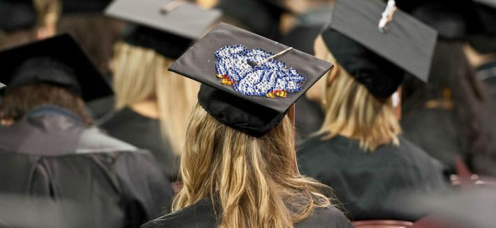UMD grad with Bulldog graduation cap