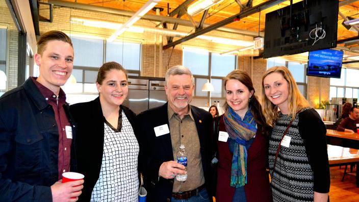 Professor John Kratz and four marketing alumni