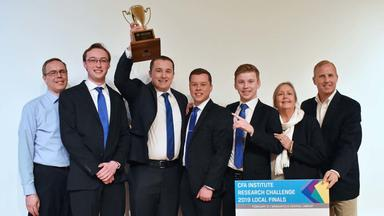 The Financial Markets team with their trophy