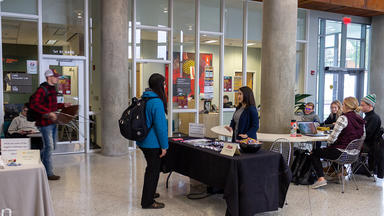 Student talking with an insurance representative in the LSBE atrium
