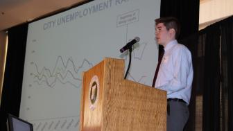 LSBE student Austin Kuhn presents data