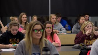 Students in the Long-term Care Course add stickers to their glasses.