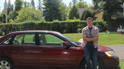 Ryan Klosterman leaning against a car