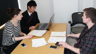 VITA students assisting a person with his 2015 income taxes