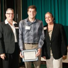 Jim Davis Economics Scholarship - Maureen O'Brien, Economics Department Chair, Adam Swinney, and Dean Amy B. Hietapelto