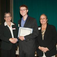 Department of Economics Scholarship - Maureen O'Brien, Economics Department Chair, Tyler Boese, and Dean Amy B. Hietapelto
