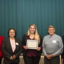Jim Davis Economics Scholarship - Dean Amy B. Hietapelto, Jo-ann Sramek, Emily Kowalcyzk, Frank Sramek, and Chris McIntosh, Economics Department Head