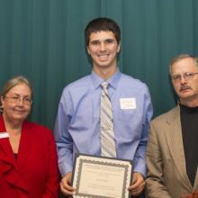 Dr. John A. Dettmann Scholarship - Dean Amy B. Hietapelto, Kyle Voelker, and Don Dettmann